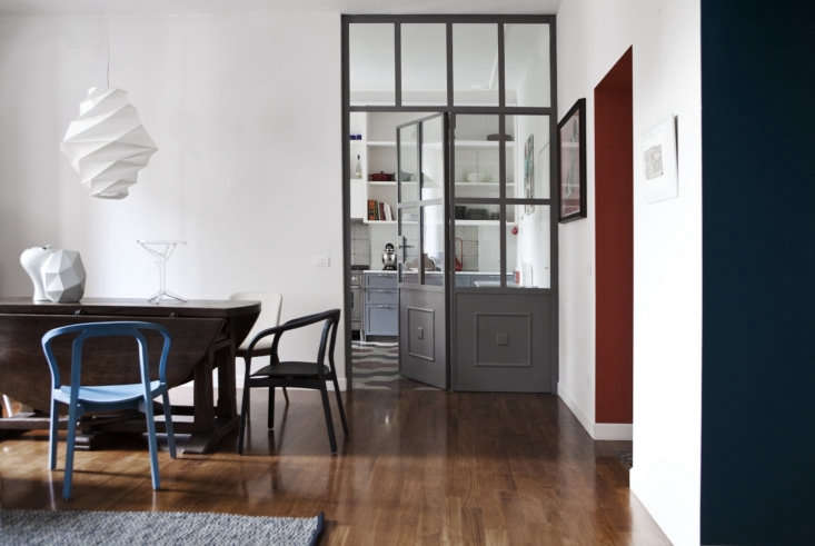 the kitchen opens onto the dining area, where a family heirloom table pairs wit 12