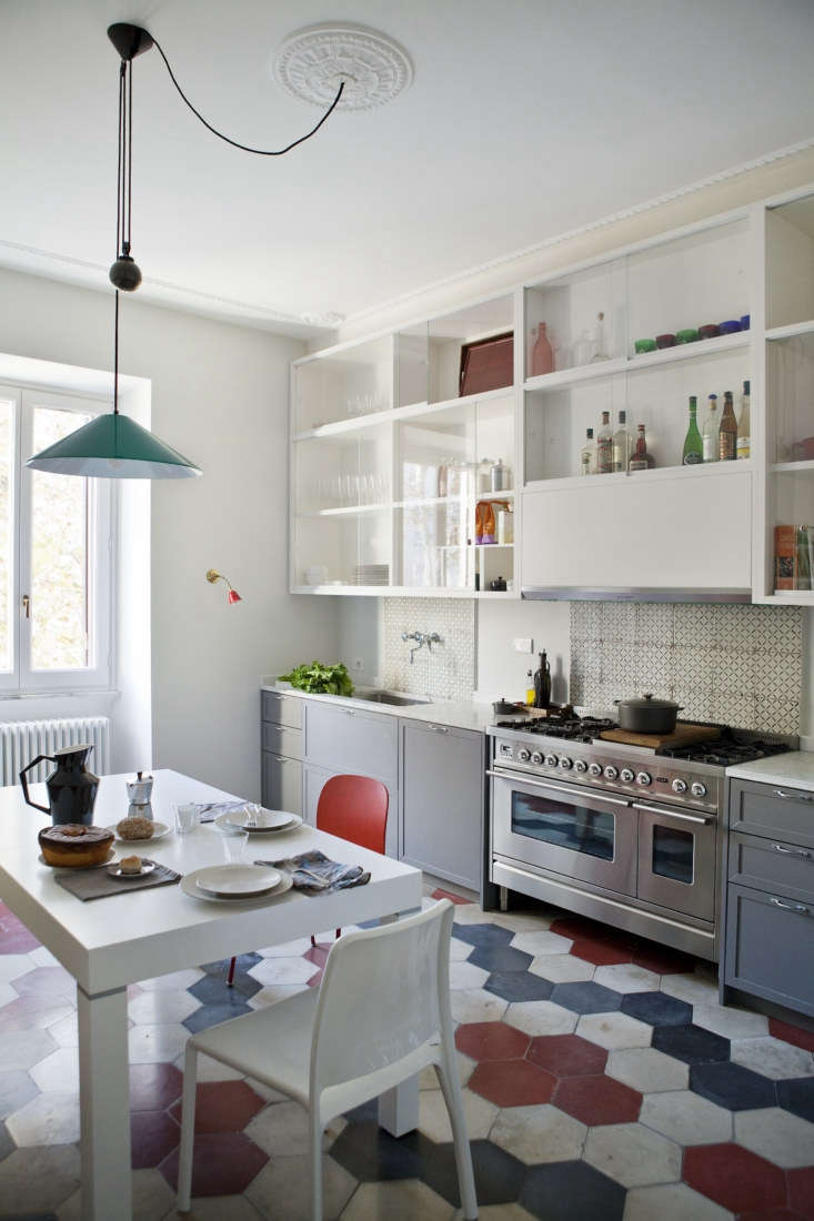 in the kitchen, a reclaimed cement tile floor sets the stage for a motif of dus 10