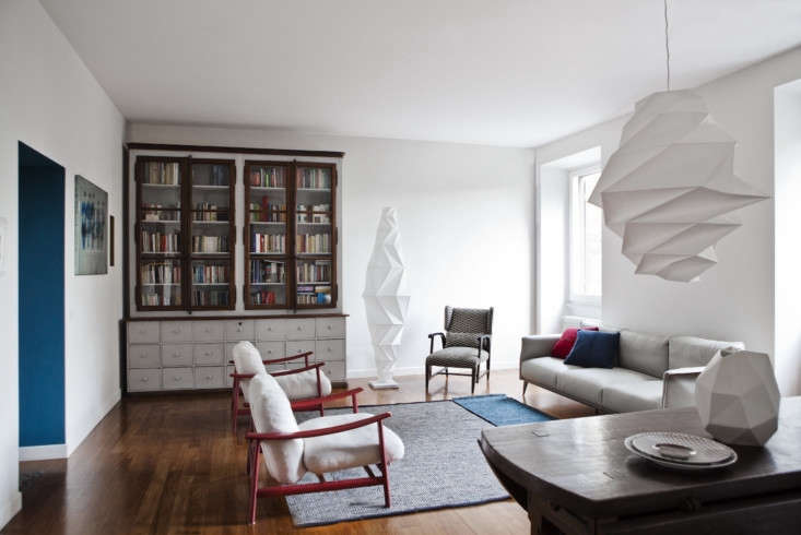 the sculptural living room is grounded bya massive hutch, the family&#8\2 13