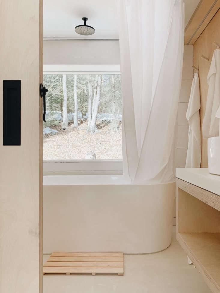 the freestanding bathtub is signature hardware&#8\2\17;s arya in acrylic (w 24