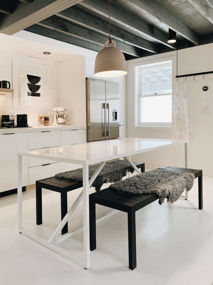 blu dot&#8\2\17;s strut table is paired with dwr&#8\2\17;seos benches 17