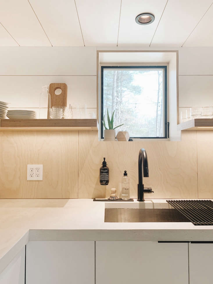 concrete counters frame an undermount sink with the couple&#8\2\17;s favori 16