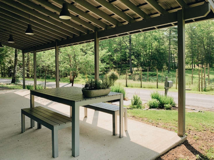 the cook house is set up for easy meals, indoors and out. the table and benches 10