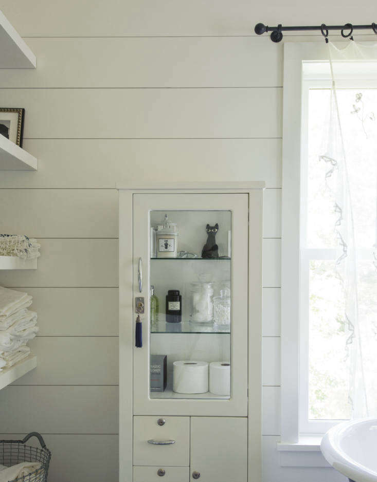 Stylish practicality: Tiina Laakonen's bathroom cabinet has a tasseled key, for flair.