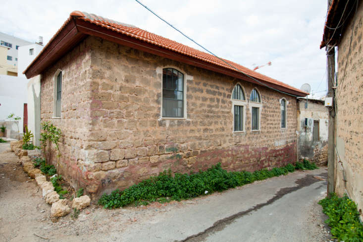 The exterior of the little house, situated on a small lane.
