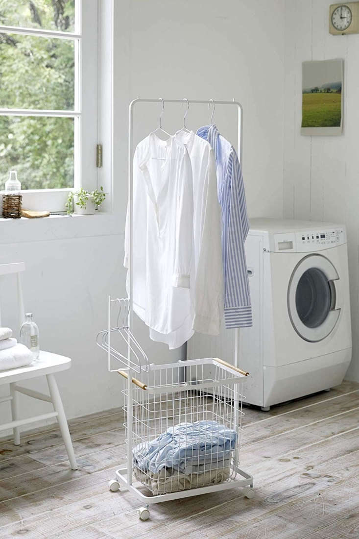 the yamazaki tosca tall laundry wagon, \$70, is a rolling clothes rack fitted w 25