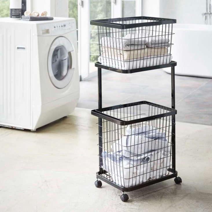 the yamazaki tower laundry wagon,\$46.\20, holds two tower laundry baskets, 26