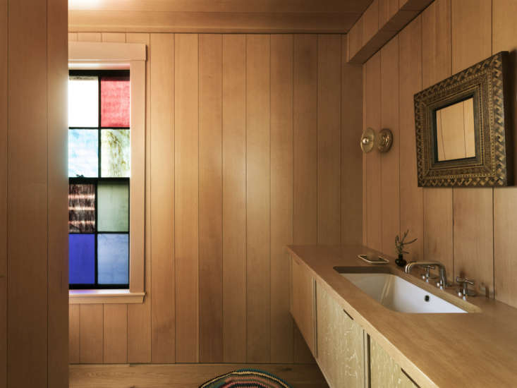 Bestor used space from the dining room and an awkward existing bath to create a cabin-like powder room. Of the Douglas fir shiplap paneling Zell says, &#8