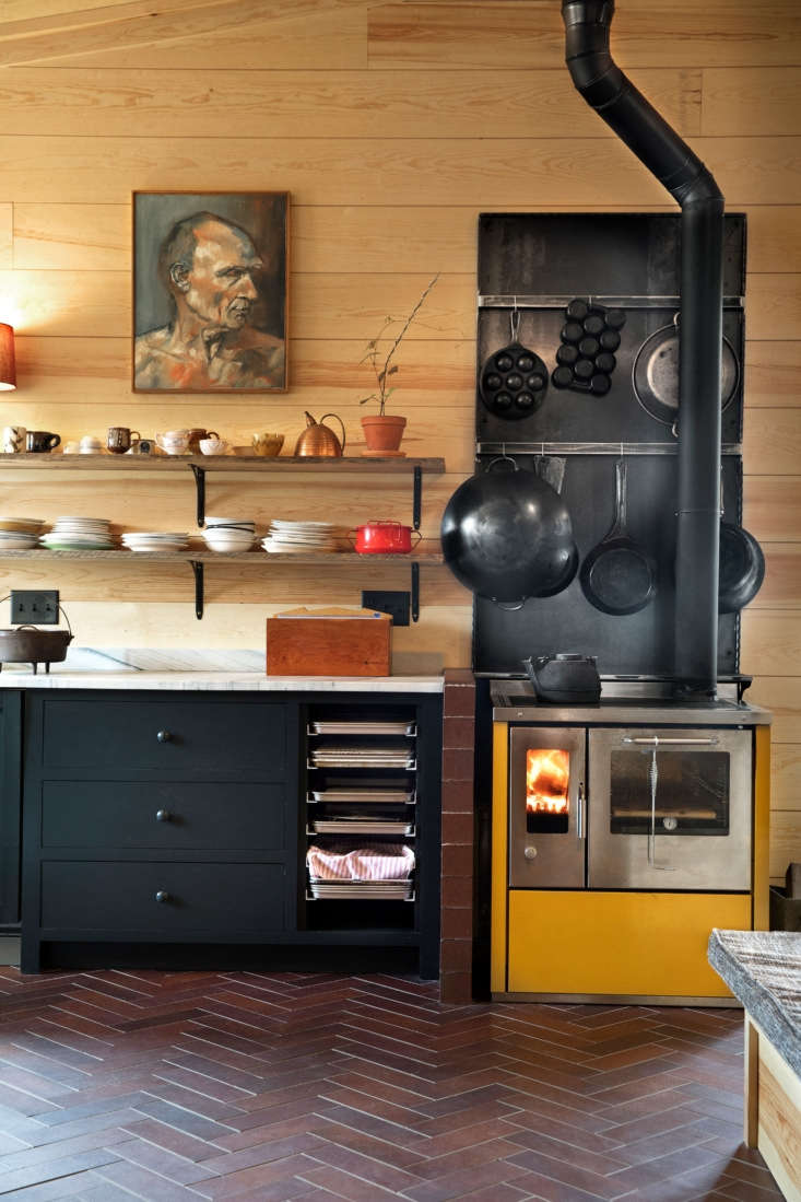The kitchen was done on a budget, but Amys only splurge was a DeManincor Italian wood stove. &#8