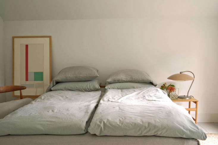 the bed is made in minutes. the organic cotton percale anton duvet covers and a 12