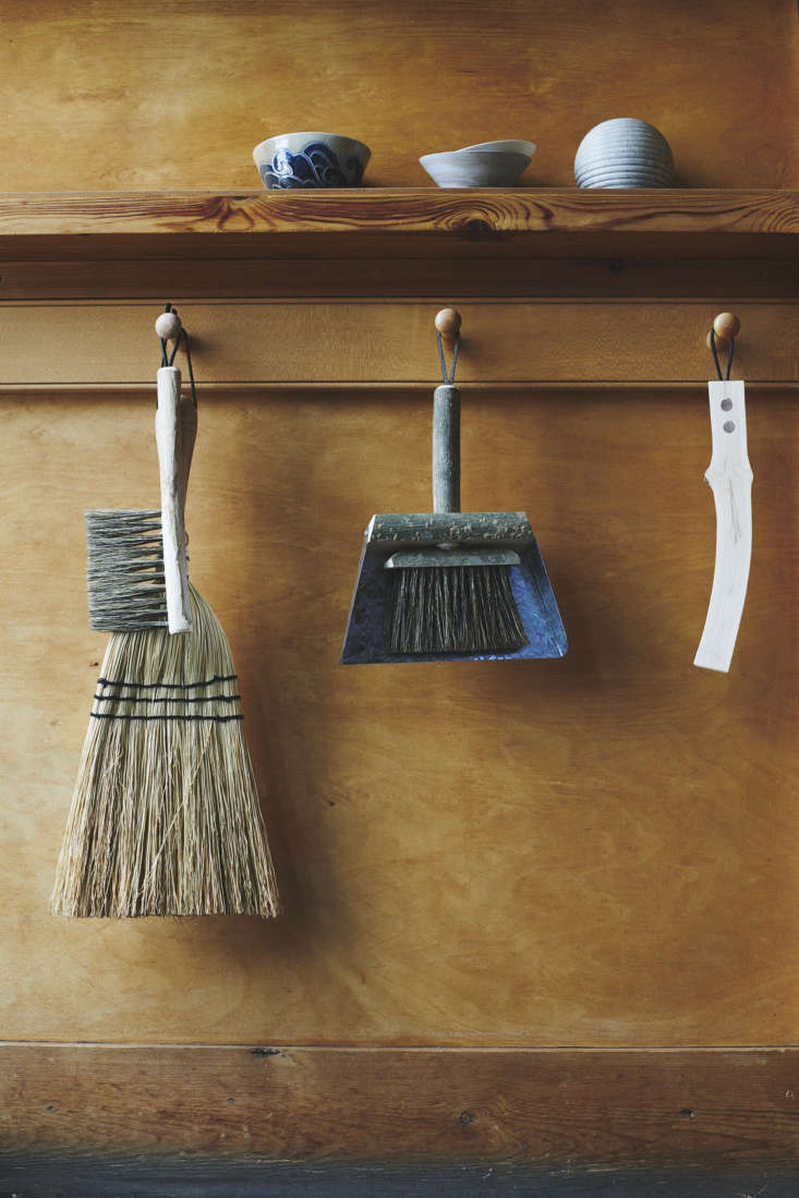 a rice straw hand brush by redecker (the larger broom at left, \$\20), and a po 13