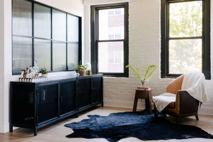 a dark credenza and hide in a nook off of the main living area. 17