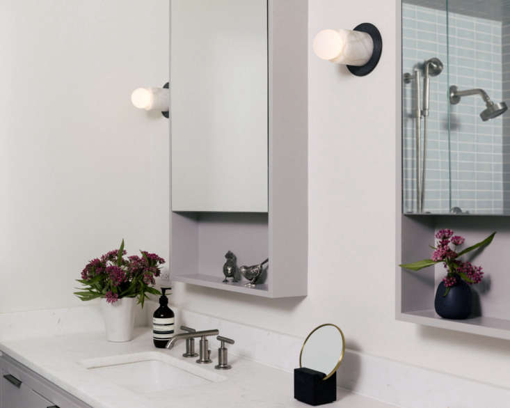 boone outfitted the bathrooms with mirrored cabinets and pale grey lavender ton 19