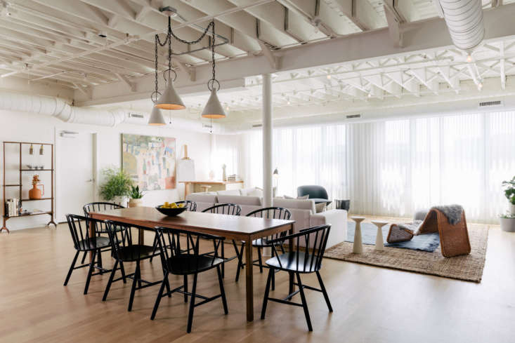 the whole of the apartment is airy and simple, with white painted timber ceilin 16