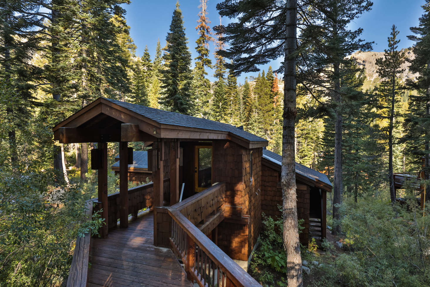 The shingled cabin was originally designed in 73 by Tahoe-based architect Charles O. Matcham Jr.; it&#8