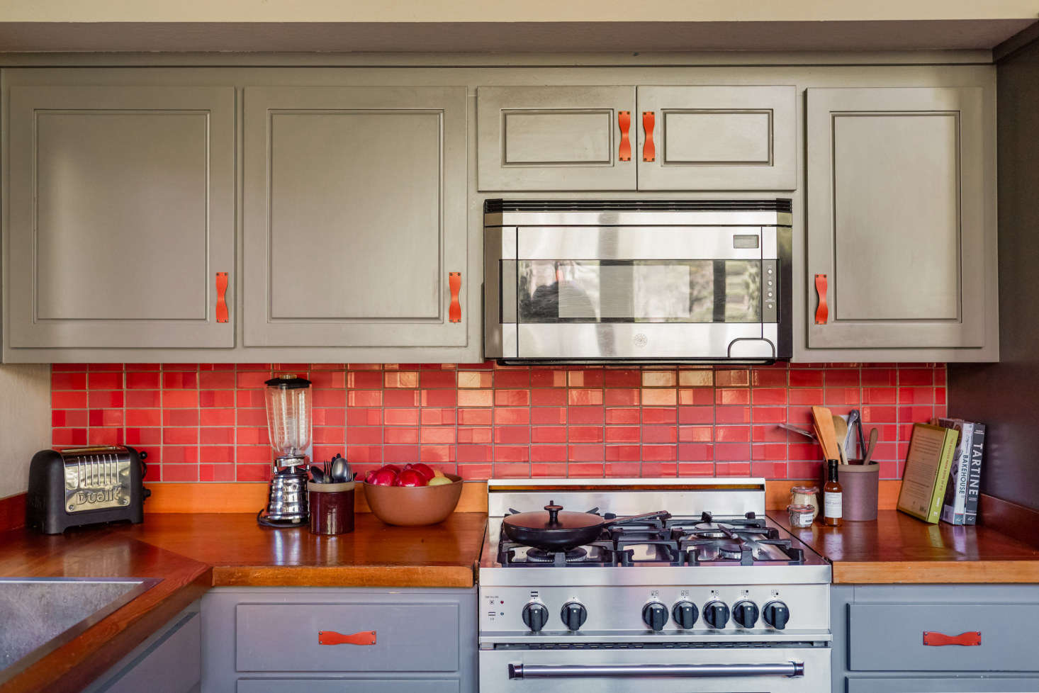 The two-tone kitchen features Heath&#8