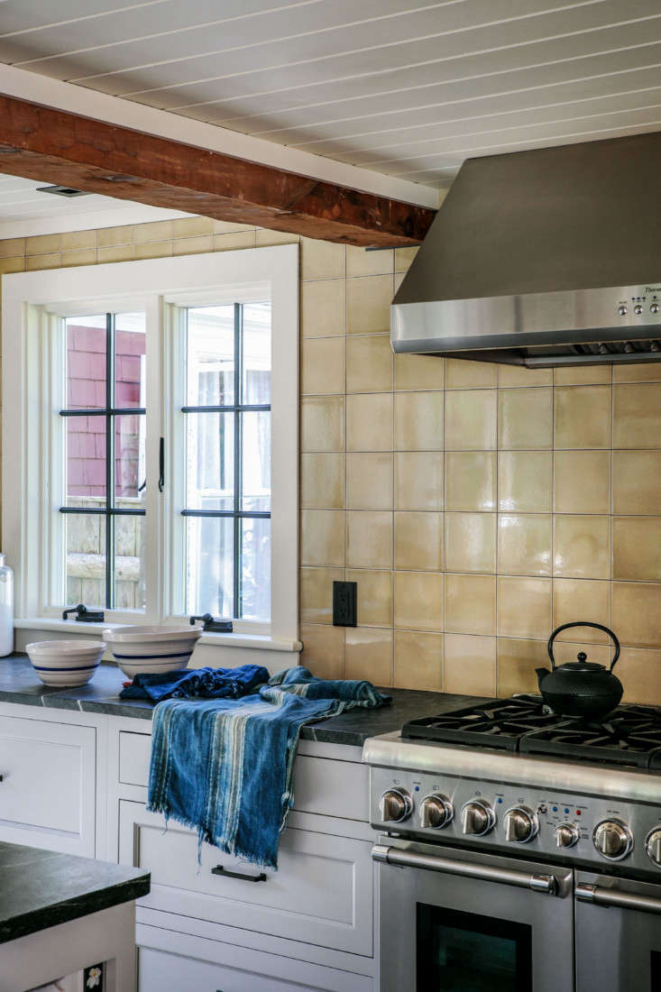 The backsplash is tiled in 6-by-6-inch Subway Tile in khaki from Heritage Tile. The counters are soapstone and the range is from Thermidor.