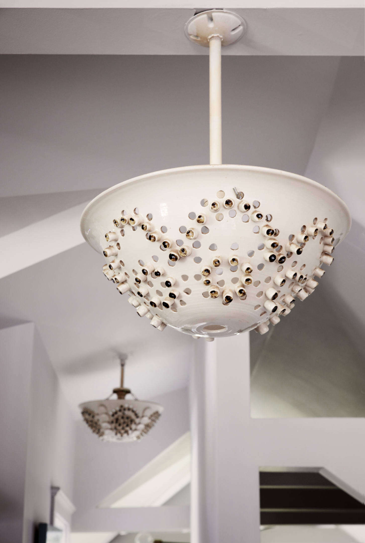 Kitchen colanders serve as light fixtures and date to Ciro Cozzi&#8