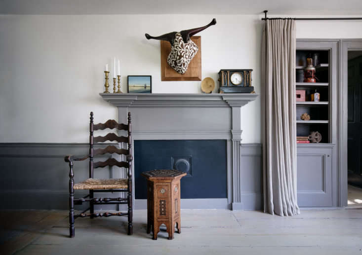 """The grouse linen """"Trophy Heads"""" wall sculpture over the fireplace is by Truro, MA, artist Breon Dunigan."""
