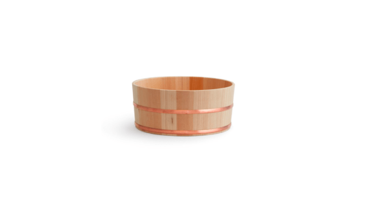 The Hinoki Copper Bath Bucket is $90 at Jinen. It's 9 inches wide and 4 inches tall and watertight. (For less expensive options, see High/Low: The Japanese Wooden Bath Bucket.)