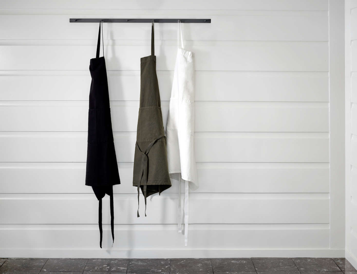The cotton/linen Apron ($78) is made by Charvet in France and is available in black, ivy, or white.