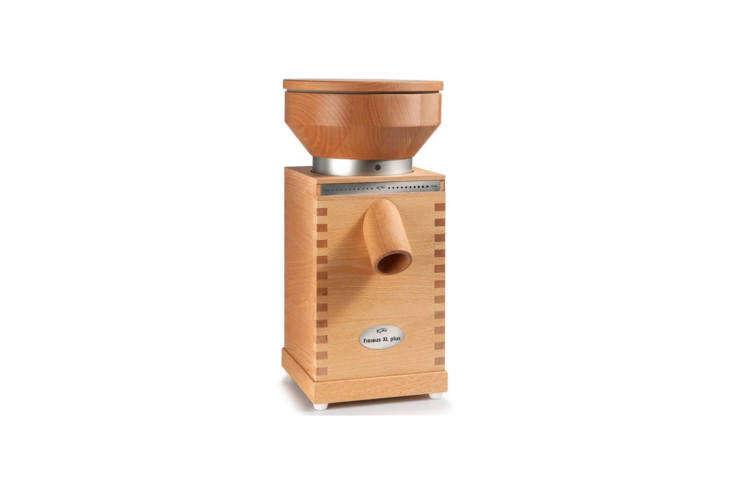 the komo xl plus grain mill has a 600 watt motor for producing \200 grams of fl 13