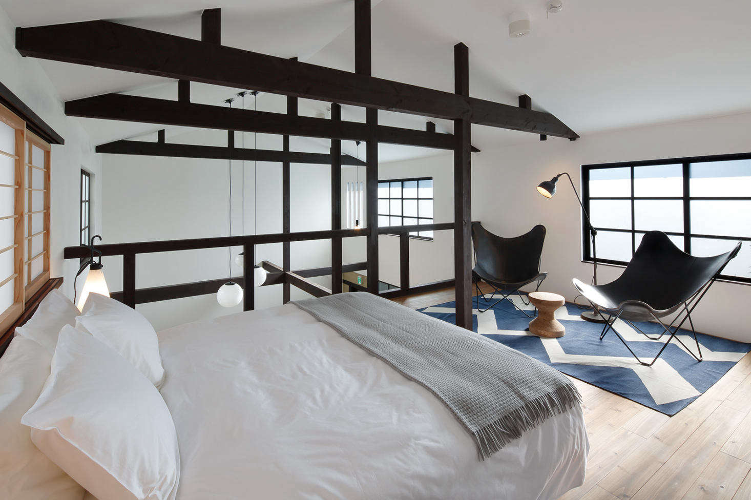 The houses are rented individually. Go-Go (no. 5), which accommodates two, has a modern, double-height interior and a rarity in Japan: a king-size bed.