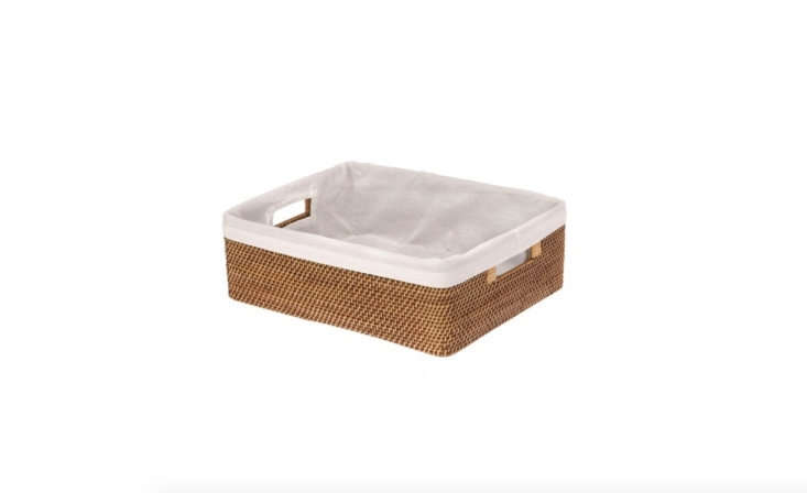 The Laguna Rattan Shelf Basket by Kouboo comes with a removable cotton liner; $49.50.