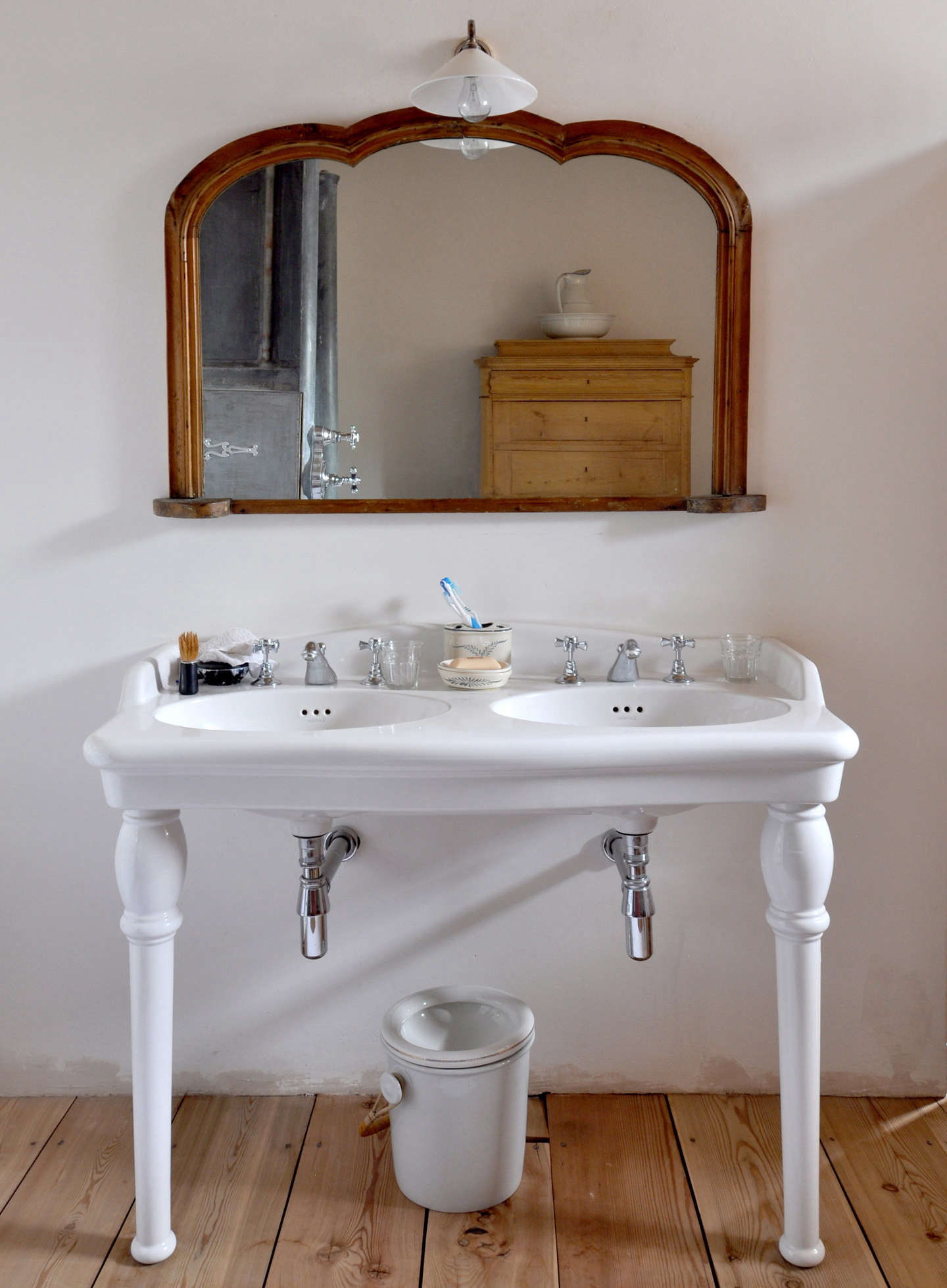 An antique double-sink vanity in the bath.