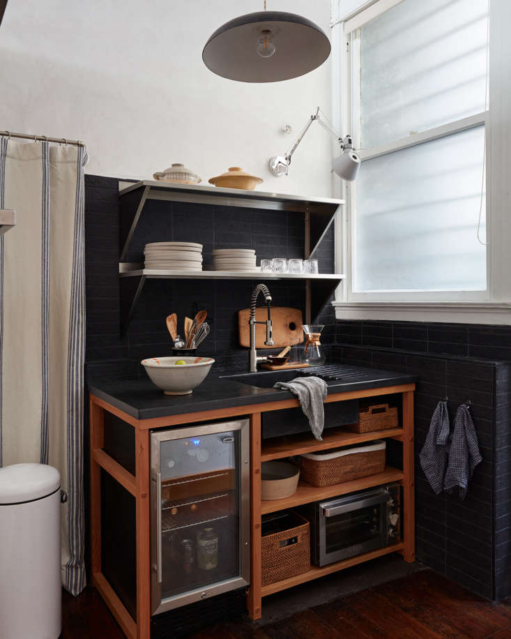 &#8\2\20;we designed each shelf space in the sink base shelving to fit spec 9