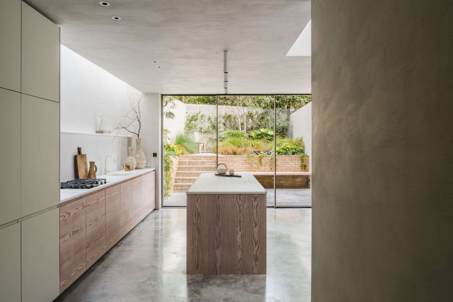 The basement level features polished-concrete flooring throughout and even extends seamlessly to the garden, just beyond the sliding doors in the kitchen.