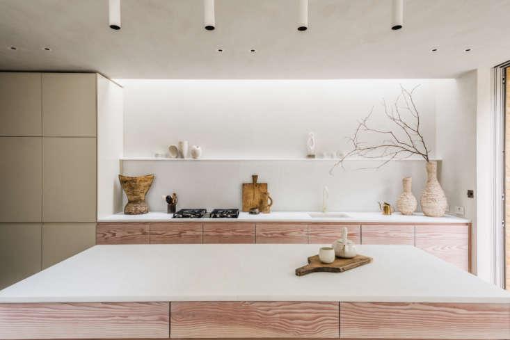 Evora marble tops the bespoke Douglas fir kitchen cabinets.
