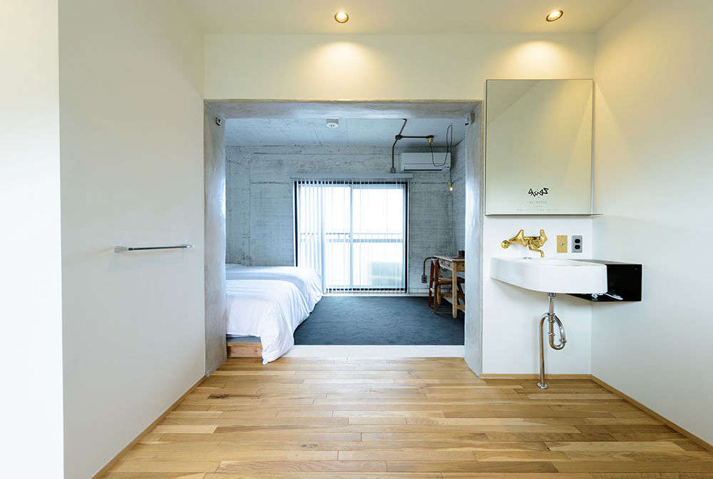 An ensuite room with a writing desk at theRC Hotel.