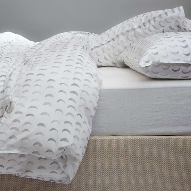 We have our eye on the Crescent Moon Duvet Cover over at Rebecca Atwood.