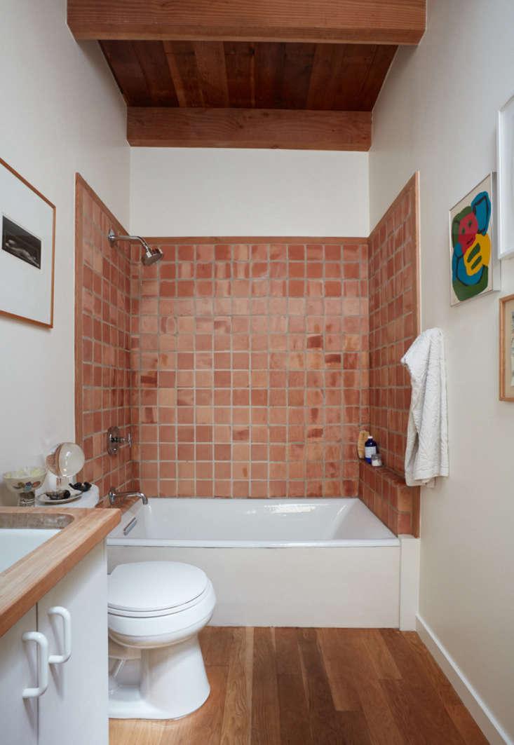 Basic terracotta tiles in the simple bathroom.