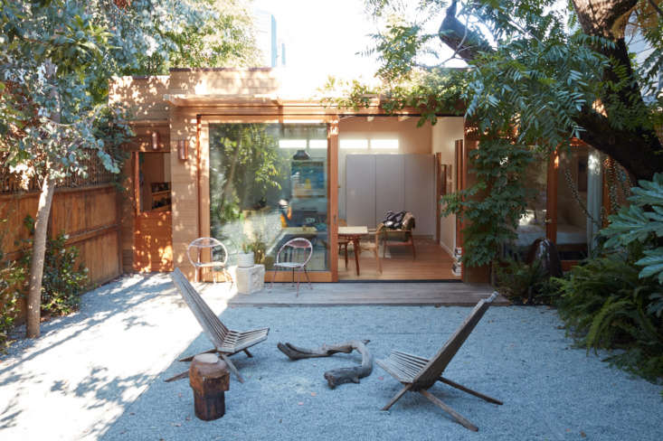 the neglected backyard is now a peaceful outdoor space with decomposed granite  10