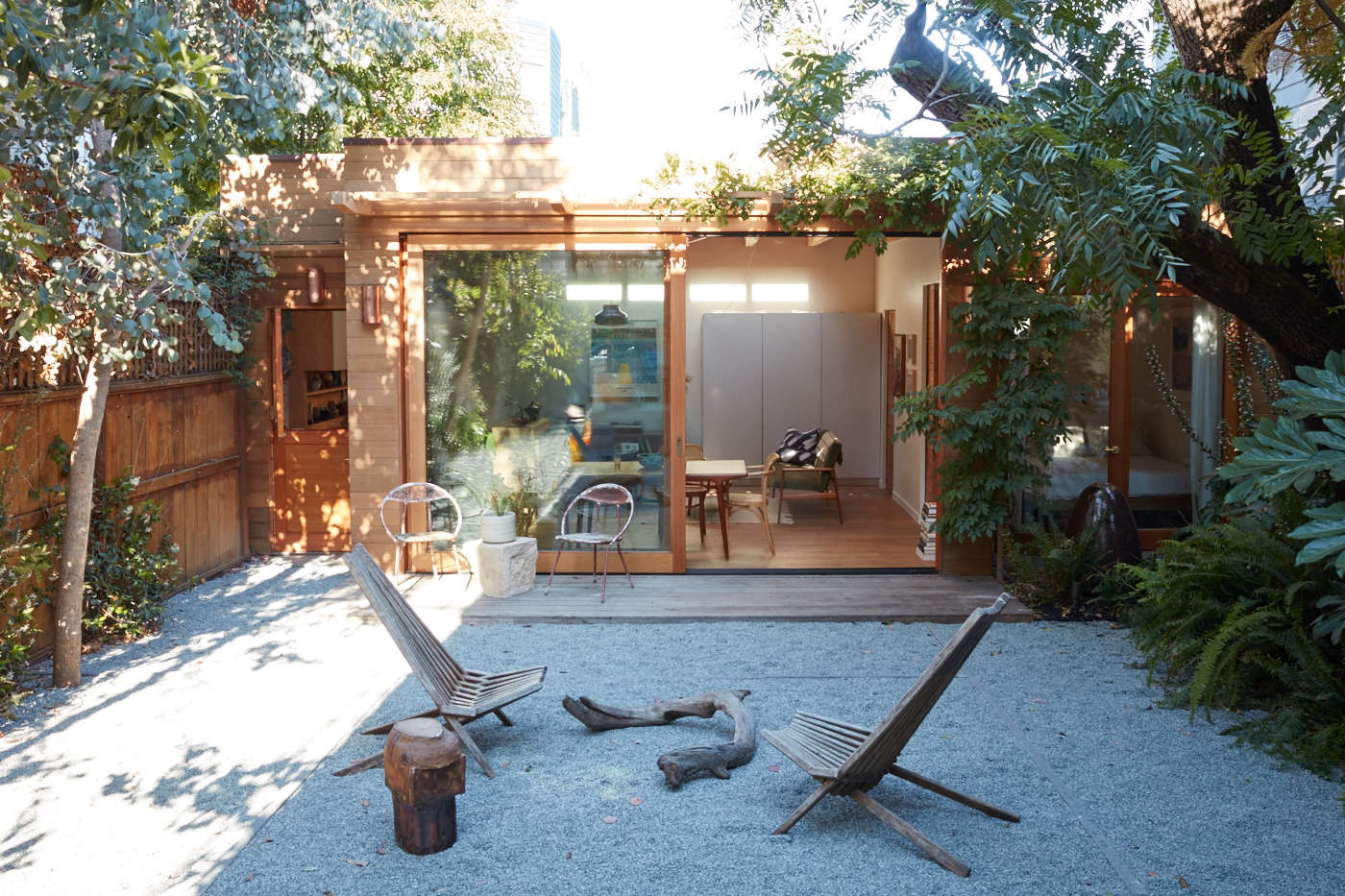 The neglected backyard is now a peaceful outdoor space with decomposed granite underfoot. &#8