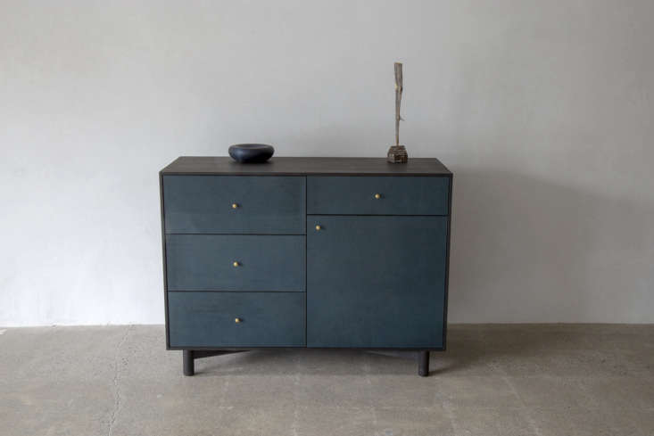 The ebonized American black walnut Chess Dresser, with teal leather front and brass handles, starts at $,900.