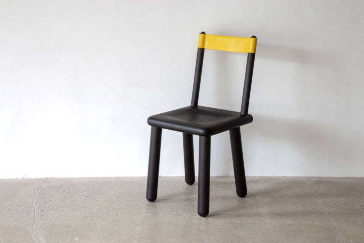 The sculptural ebonized American black walnut Threaded Minna Chair features a neon yellow leather backrest; from $