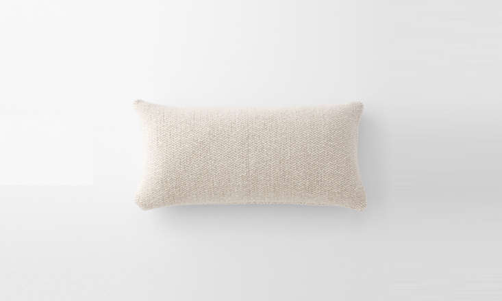 the timeless, neutral ivory wool lumbar pillow (\$\1\28) is filled with down an 14
