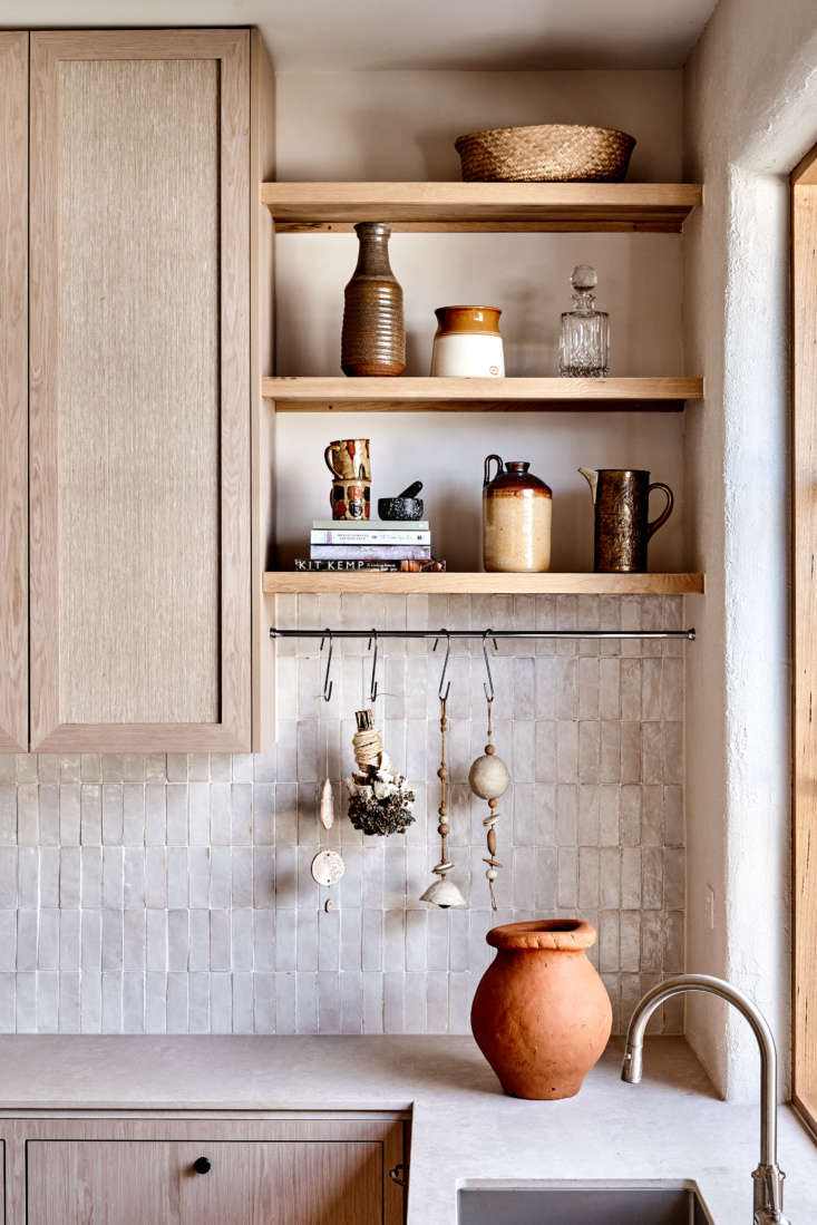 The cabinets are faced with a wood veneer from New Age Veneers&#8