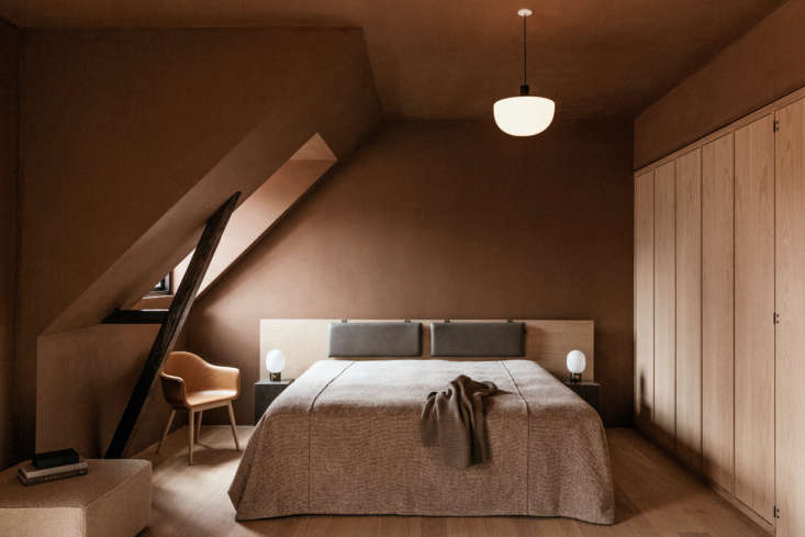 Copenhagen Clubhouse The Audo A New Creative Hub with Hotel Rooms Under the Rafters The organic cotton bedding is by Danish cult brand Aiayu. Yoga mats available on request. For reservations, go to The Audo. Photograph by Mario Depicolzuane.