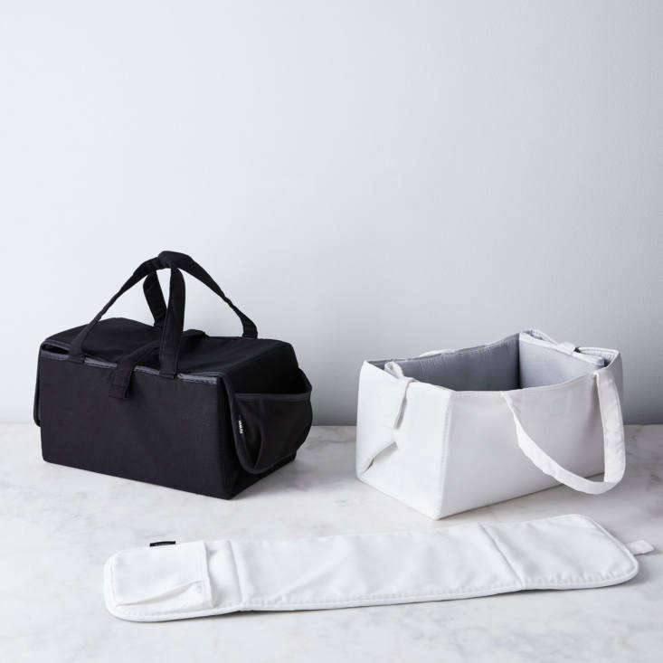 the yamazaki ironing board in a bag is composed of two ironing mats (one large, 27