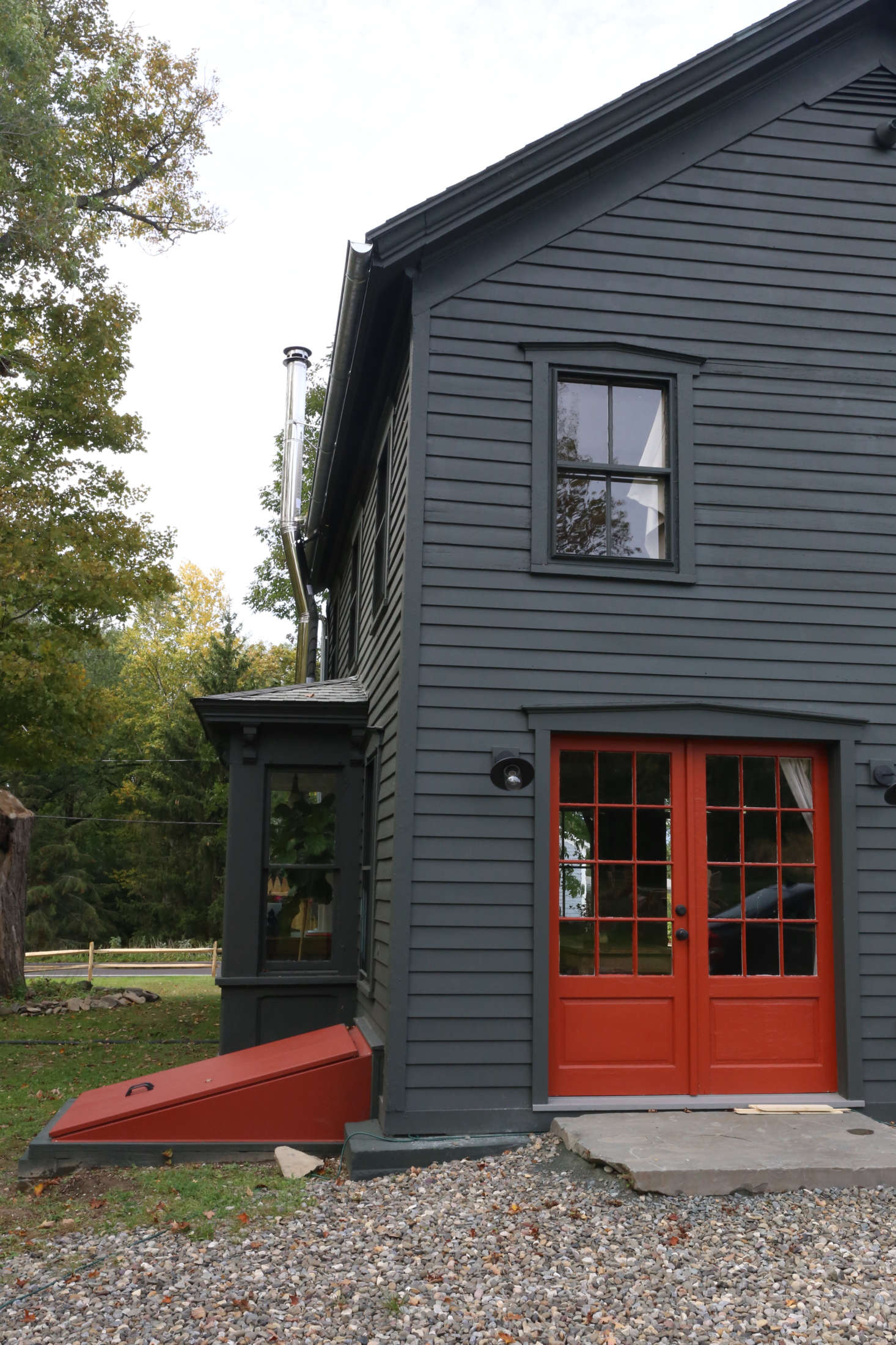 The back doors and basement bulkhead are also Benjamin Moore Grand Canyon Red: &#8