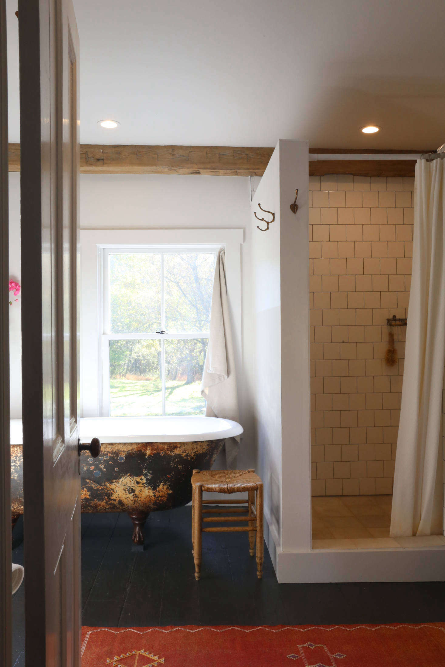 The rebuilt upstairs bath has a new-old look. The tub, along with three sinks, came from Hoffman&#8
