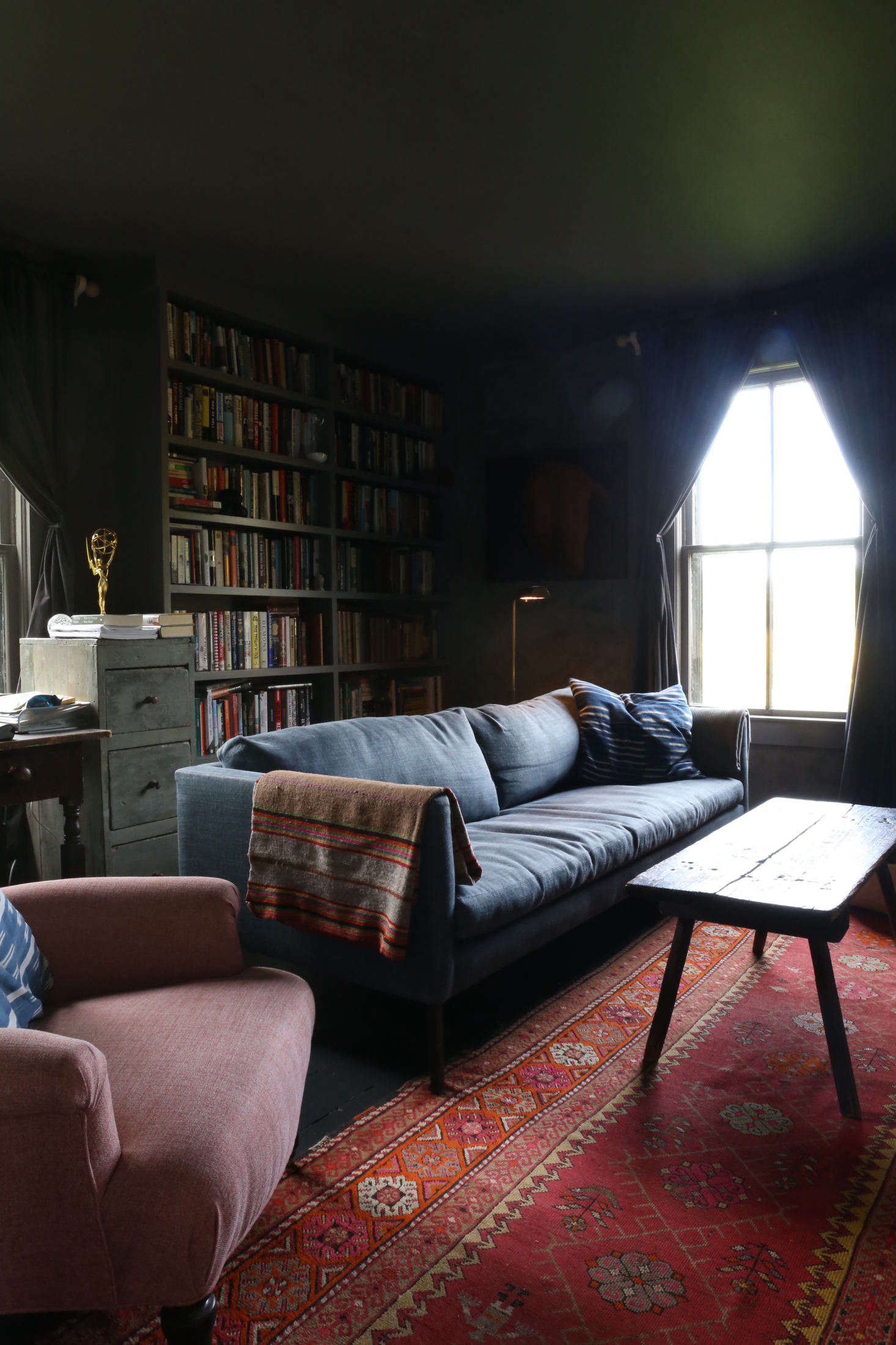 The moody back room with new built-in bookshelves is the library/TV room and Corbin&#8