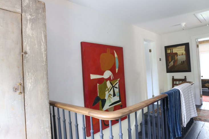 There are three bedrooms upstairs. The red painting, by Peter Aspell, is &#8