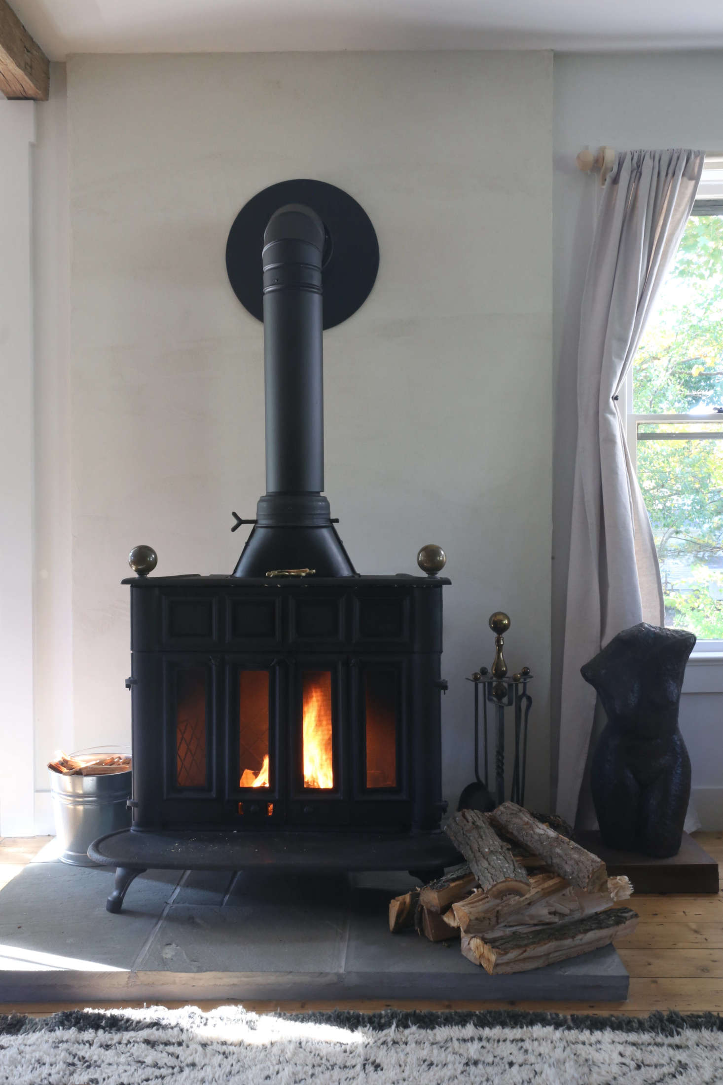 The vintage Franklin stove came from Hoffman&#8