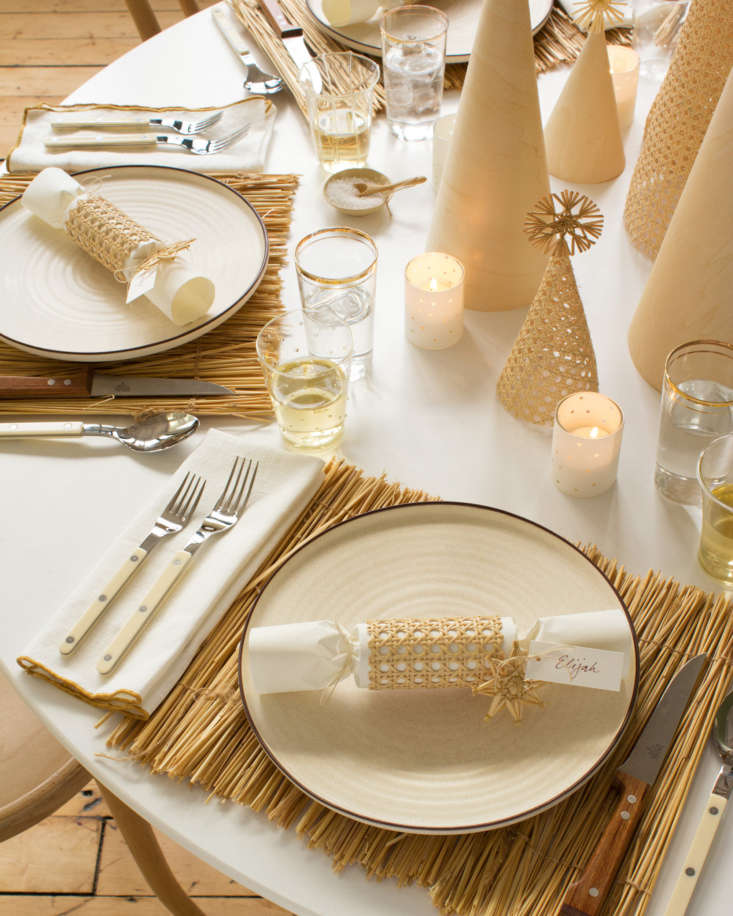 A DIY party popper (also known as a Christmas cracker) adorns each place setting.