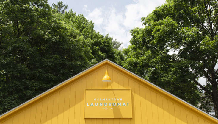 The exterior, inspired by a Scandinavian summer house, is painted in Sherwin Williams Mod Yellow and Benjamin Moore Apple Crisp.